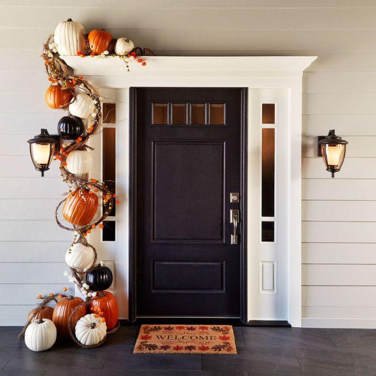 Love the front door, crown above door and side lights. the Pumpkin Garland Door Décor is cute too.