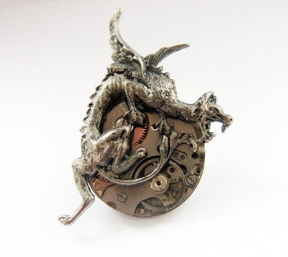 Steampunk dragon brooch.  To distract from your boobies.