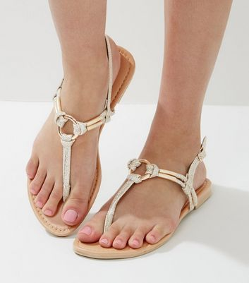 - Gold finish- Ring strap design- Ankle strap fastening- Flat sole
