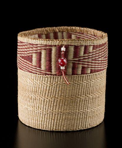 Berry Basket (Lightning design) by Diane Douglas-Willard, Haida artist. Medium: red cedar bark, yellow cedar bark, wax linen, bone beads, antique skunk beads. Shown at Spirit Wrestler Gallery, Vancouver, BC.