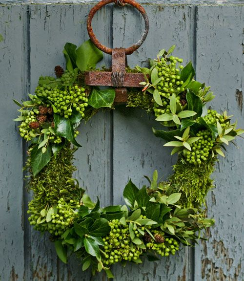 Welcome visitors with a handmade evergreen wreath on the front door.