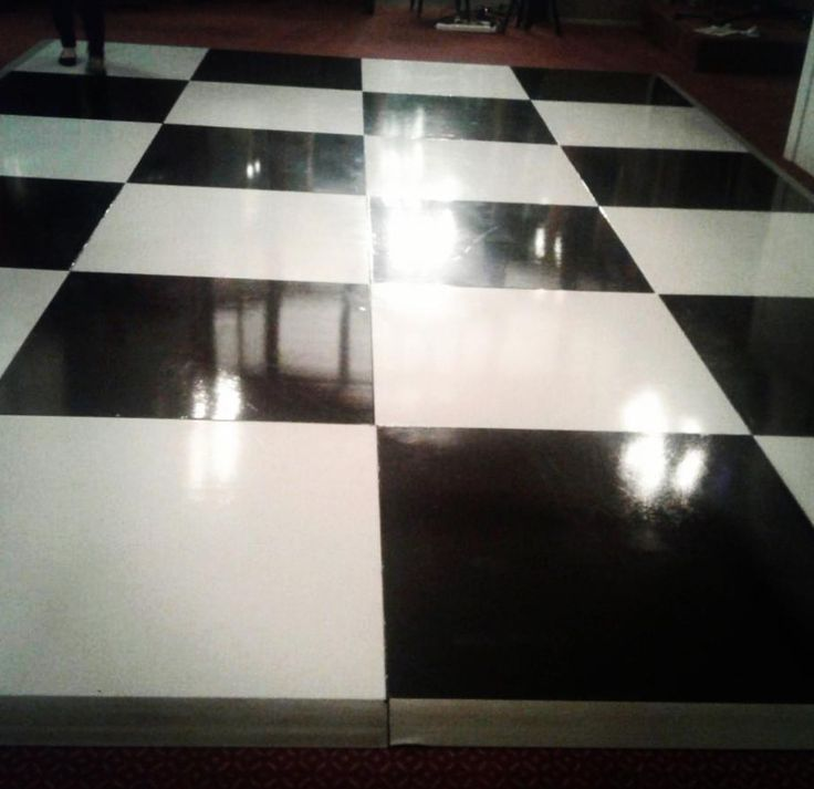 A close up of a black and white check painted dance floor. Looking good #connectafloorcape #eventflooringcapetown