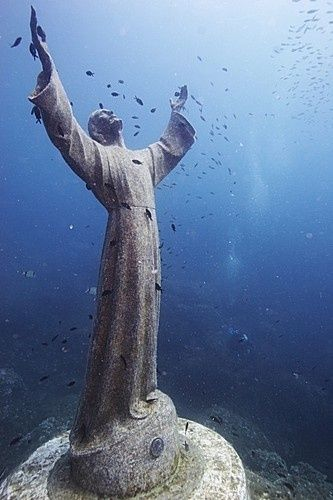 "Underwater statue on the Italian Riviera. (Titled Christ of the Abyss)  ""Where can I go from your spirit? From your presence, where can I flee? If I ascend to the heavens, you are there; if I lie down in Sheol, there you are. If I take the wings of dawn and dwell beyond the sea, Even there your hand guides me, your right hand holds me fast."" Psalm 139:7-10"