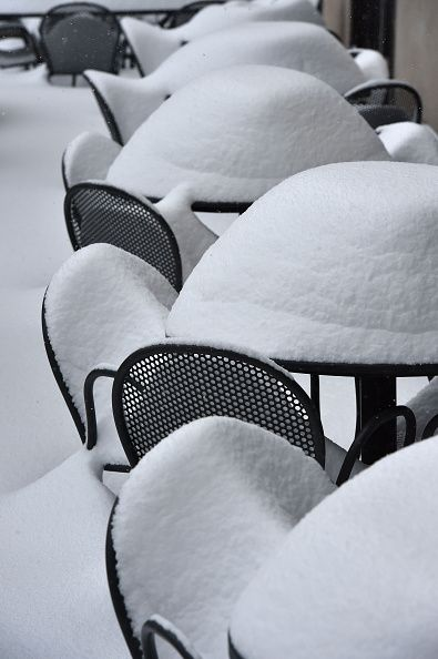 #TOPSHOT A snow covered restaurant terrace is seen in Washington DC January 23 2016 A deadly blizzard with bonechilling winds and potentially...