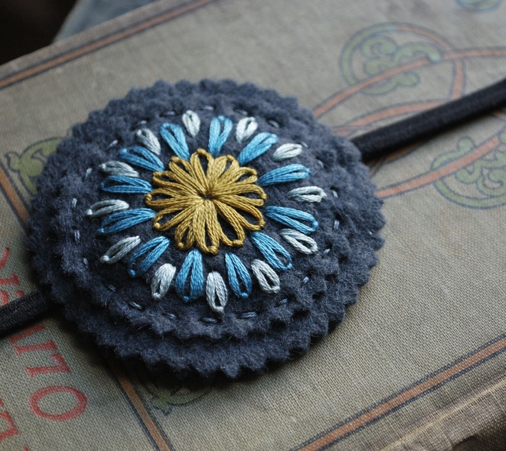 Felt Headband Hand Embroidered Slate Blue Wool Felt with Turquoise, Light Blue and Mustard Yellow Embroidery by love maude. $16.00, via Etsy.