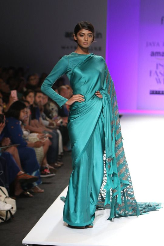 Here are some photos of designer Jaya Rathore's collection at Amazon India Fashion Week Autumn/Winter 2016. The wonderful collection of outfits consisted of blue, cream and purple tones, large gorgeous dresses and chic saree, which made for a striking display. #Amazon#AIFW#2016#Autumn#Winter#Fashion#Models#Indiandesigner#Strandofsilk#catwalk#indianfashiondesigner#jaya rathore#amazonfashionweek2016#sarees#designer sarees