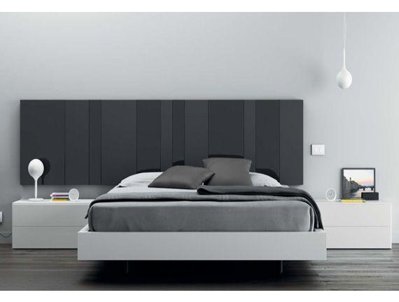 Dormitorios minimalistas. Cabezal de cristal brillo y mate en tono grafito.