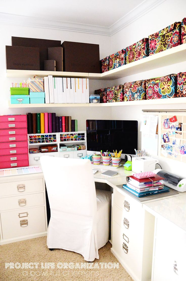Home office with plenty of junk, but neat organised in colourful boxes.
