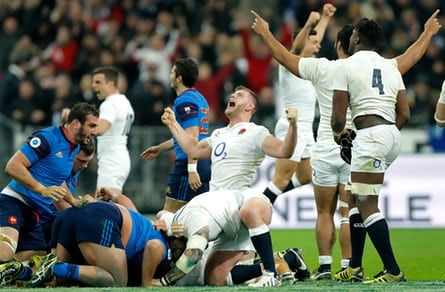 George Kruis (centre) and the other England players celebrate the Grand Slam as the referee blows the final whistle during the France v England Six Nations international rugby union match at the Stade de France