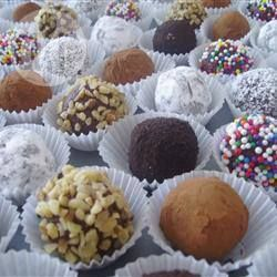 Quick Chocolate Truffles | These truffles are so easy to make and beautifully rich. Decorate with finely chopped nuts or roll in chocolate sprinkles. | @ allrecipes.com.au