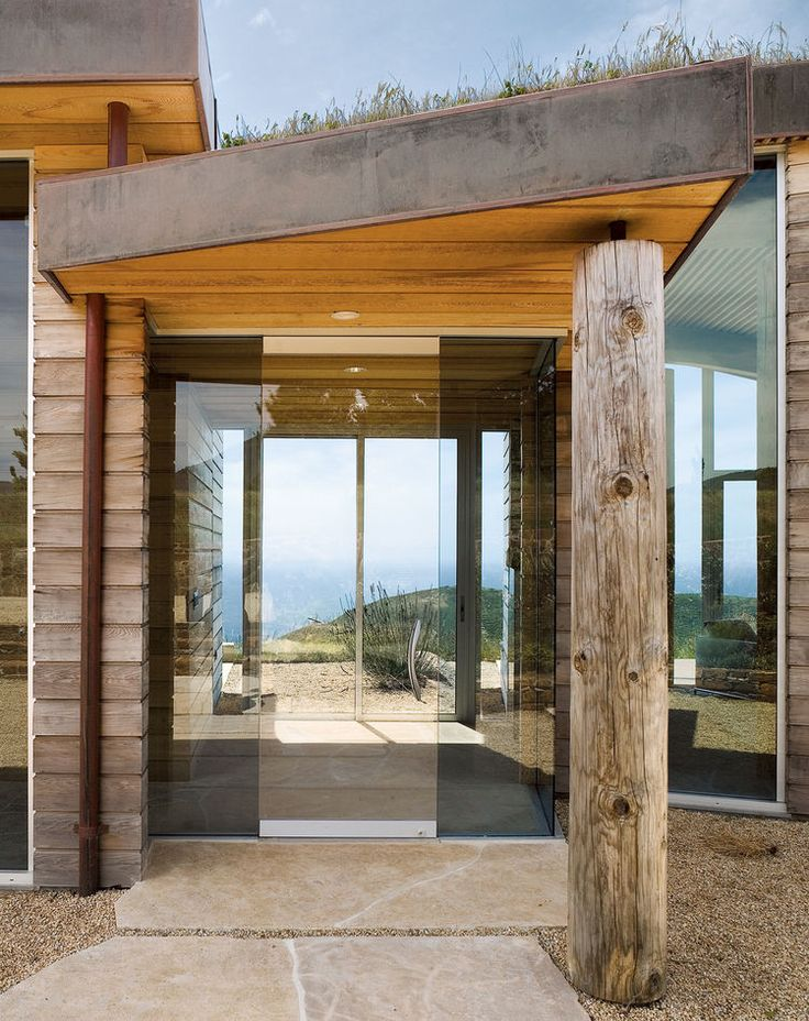 I love the design of this small modern coastal home in Big Sur and how the entryway feeds directly onto the back patio (and that killer view).