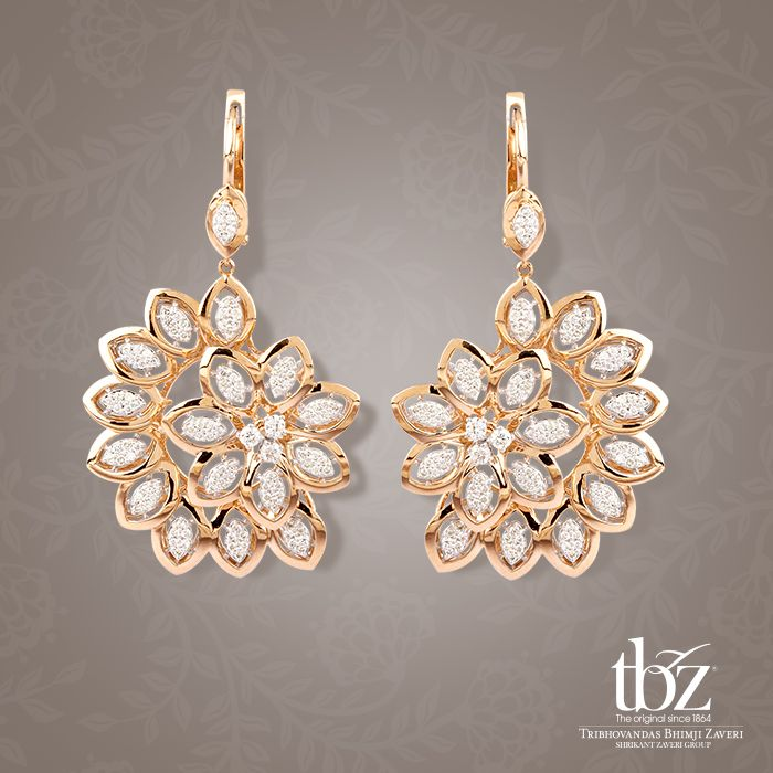Distinctly stand out when you hit the floor in these asymmetrical yet dazzling pair of diamond earrings.