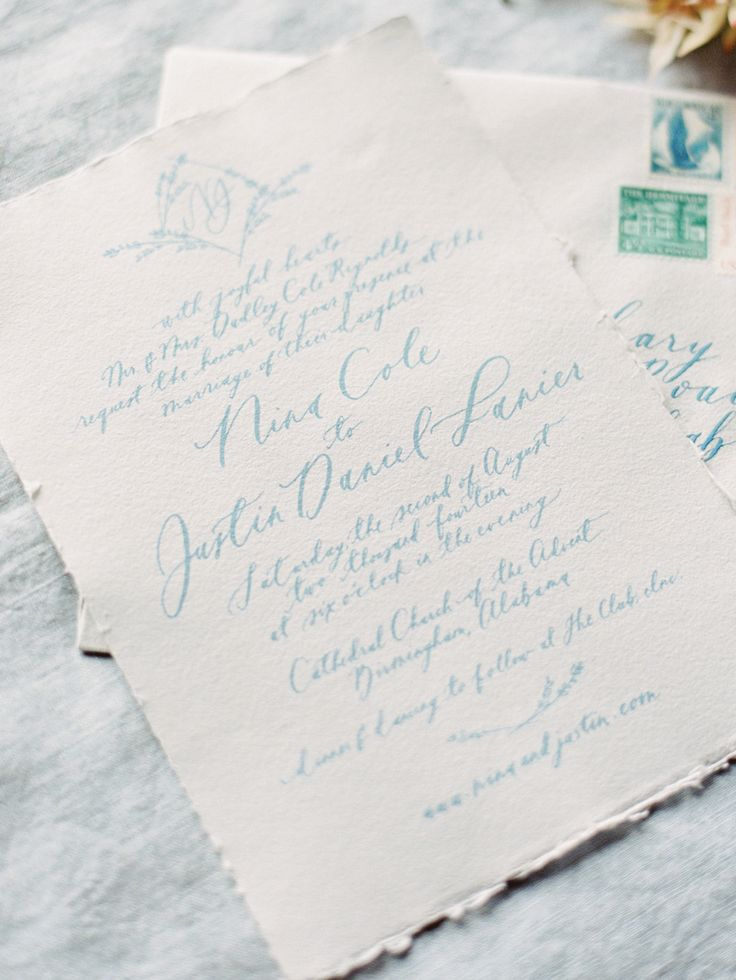 Wedding invitation with pale blue calligraphy on deckle edge paper by Brown Linen Design. Image by Ryan Ray.