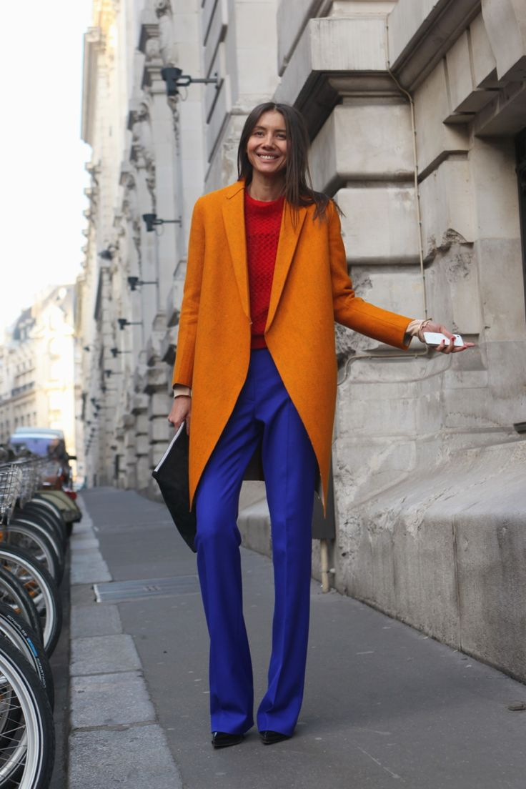 Orange coat + blue trousers. #PFW #StreetStyle Photo: WGSN http://wgsn.tumblr.com/post/44537261920/bright-colour-blocking-at-its-best-streetstyle