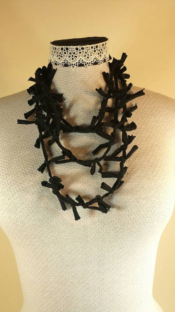 Check out this item in my Etsy shop https://www.etsy.com/ca/listing/271441400/knotted-all-black-recycled-tshirt