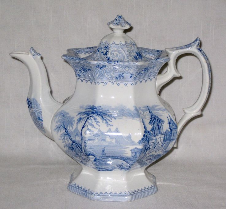"Antique Wedgwood Geneva Ironstone Teapot complete with Lid. ANTIQUE IRONSTONE TEAPOT. with the J. Wedgwood Ironstone ""Q"" ribbon logo. Blue and white transferware in the Geneva pattern;. with pattern name Geneva. 10 ins high c.1847"