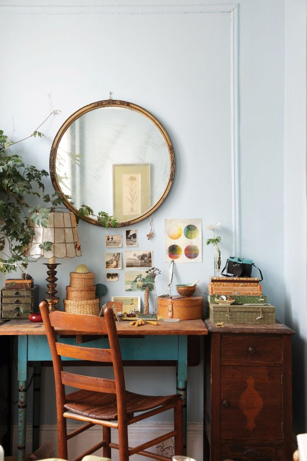"""""""This lovely desk was a great yard sale find- i love the turquoise painted legs. The grape ivy and the lamp belonged to my grandmother. I collect old mirrors and am always moving them around the apartment to play with their light bouncing effects."""" Styled by Nicolette Owen 