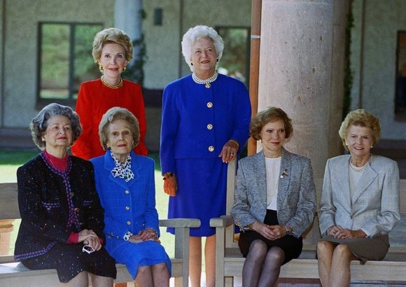 First Ladies Nancy Reagan, Barbara Bush (standing, left to right), Lady Bird Johnson, Pat Nixon, Rosalynn Carter, and Betty Ford (seated, left to right) at the dedication of the Ronald Reagan Presidential Library, November 1991