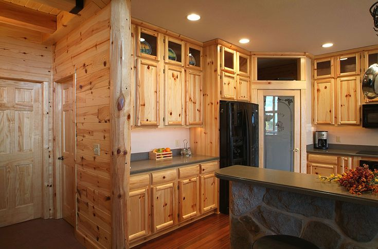 Kitchen half log siding - 8-inch prefinished knotty pine paneling with 8-inch outside corner, log style knotty pine kitchen cabinets.