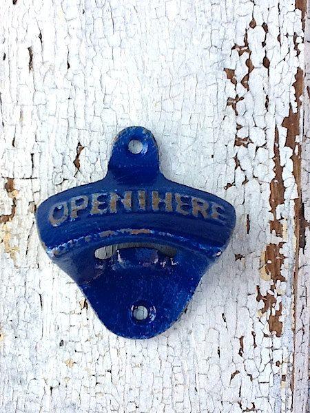 Mediterranean blue bottle opener. I need this in my kitchen.