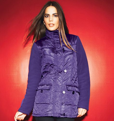 Quilted Coat Cozy has never looked cuter! Quilted shell with polar-fleece sleeves and a neck-warming mandarin-style collar. Zip and button-loop closure. Two flap pockets. Fully lined. Polyester. Machine wash and dry.