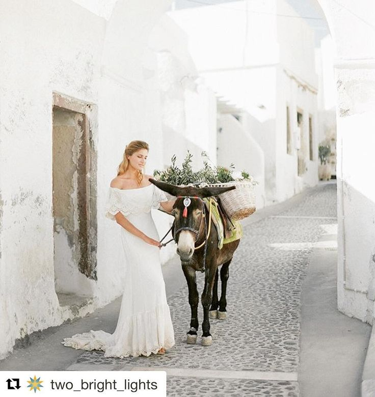 #Repost @two_bright_lights (@get_repost)  This Santorini Village bridal portrait session is a complete dream. And how stunning is that bride's off the shoulder bohemian gown?! Published on @elysian.bride photographed by @sotiris_tsakanikas and #poweredbytbl.