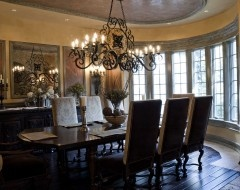 the chandelier and the mirror, and the dark wood, love the windows too and the curved shape