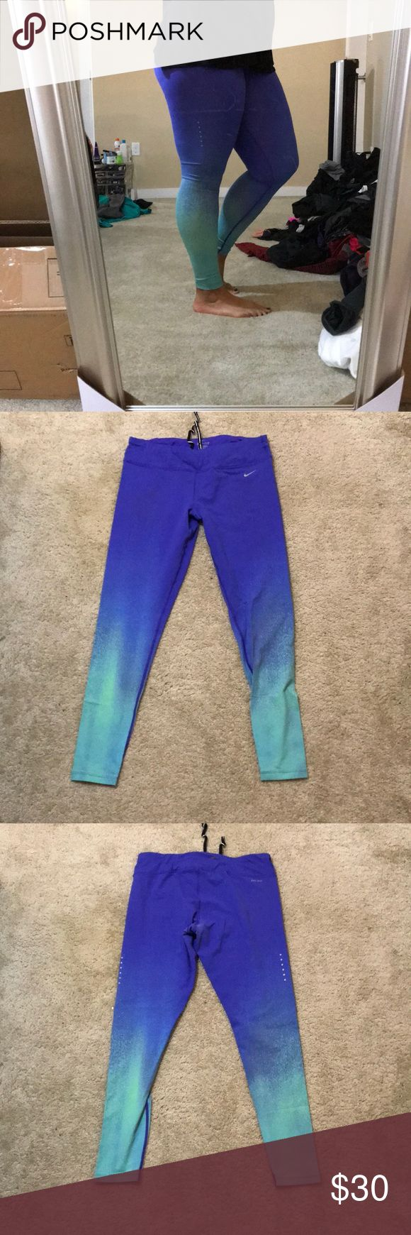 Nike epic run tights Fun colored print nike epic run tights. Super comfortable for working out or lounging. In great condition. Some of the color may be wearing off on the inner thighs but it's not at all noticeable when worn. Nike Pants