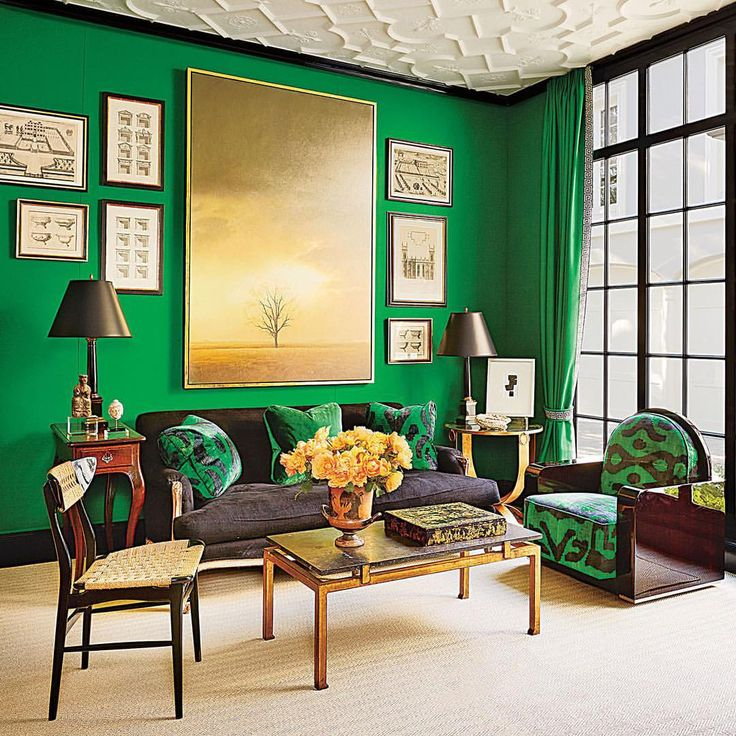 Emerald walls play off a textured ceiling in this @milesredd–designed family room. Click the link in our bio for more daring green spaces. Photo by @loof39