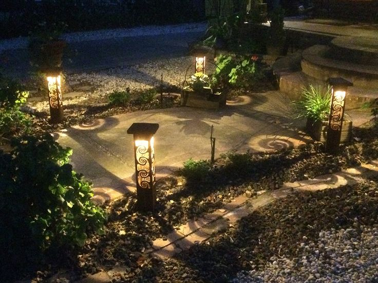 Custom landscape lighting and metal sculptural sestak design with sidewalk swirls fresh homes design