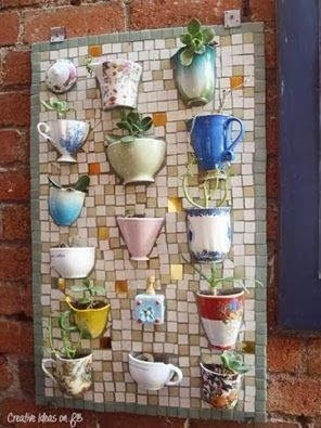 A great idea for using chipped mugs and cups to create a unique garden ornament - perhaps use them for herbs for tea!