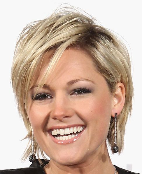 Helene Fischer Layered Razor Cut  Helene is both funky and feminine with a layered cut and long side bangs.