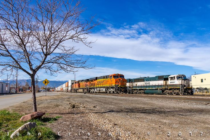 https://flic.kr/p/ZmyPj4 | Hot Q-Train and Local Power | A trio of BNSF GE's lead the Alliance-Portland Q-Train (Q ALTPTL6 17F) as it passes through Longmont, Colorado alongside the Longmont Switch power sitting on the house track on November 19, 2017.