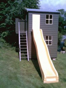 Playhouse and Shed combo idea with a slide for an extra touch