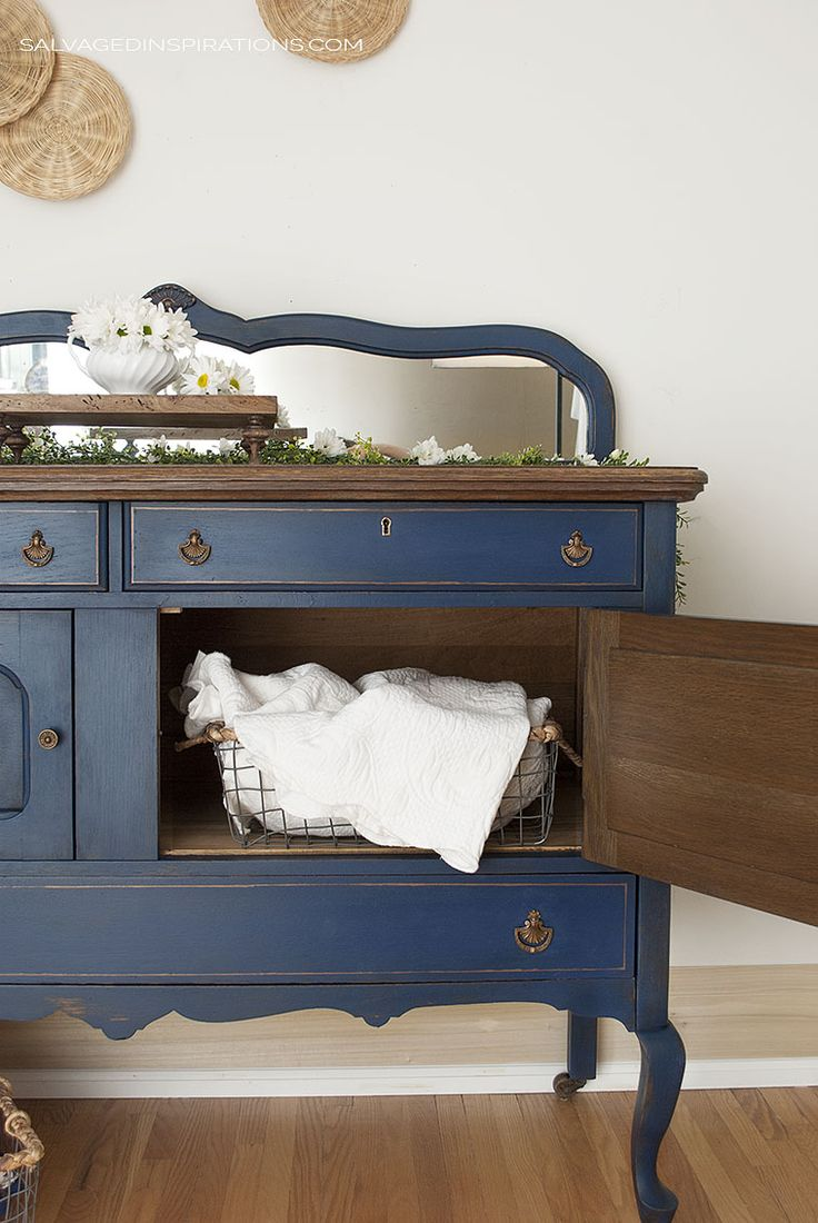 DIXIE BELLE BUNKER HILL BLUE BUFFET | I restyled this buffet with a Chestnut stain and vibrant blue paint. It really updated the piece while keeping its old world character. | Salvaged Inspirations #salvagedinspirations #paintedfurniture #furnituremakover