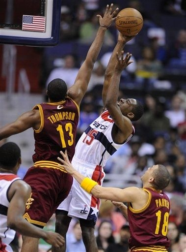Washington Wizards guard Jordan Crawford (15) shoots against Cleveland Cavaliers forward Tristan Thompson (13) and Anthony Parker (18) during the first half of an NBA basketball game, Saturday, April 14, 2012, in Washington. (AP Photo/Nick Wass)