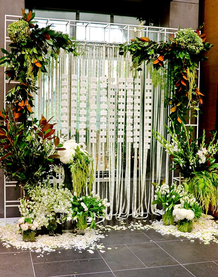 The escort card display was a great focal point. Wedding at Grand Hyatt Melbourne. Flowers and styling by Capote & Peachy.