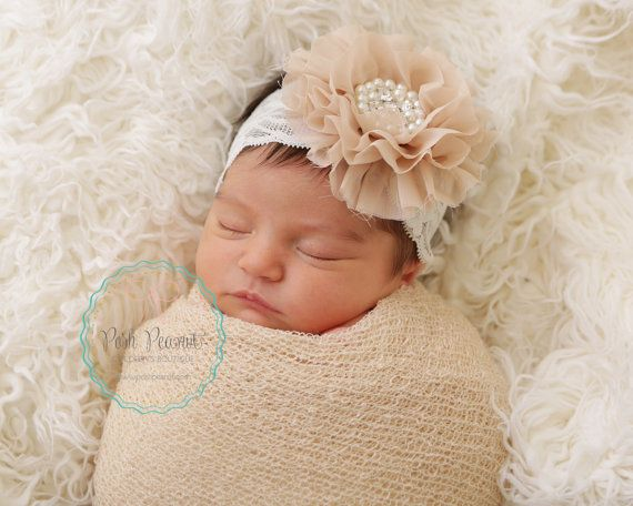 Rhinestone and pearl chiffon flower with lace headband. Blush or champagne are a perfect addition to any Posh closet. Neutral tones set to match