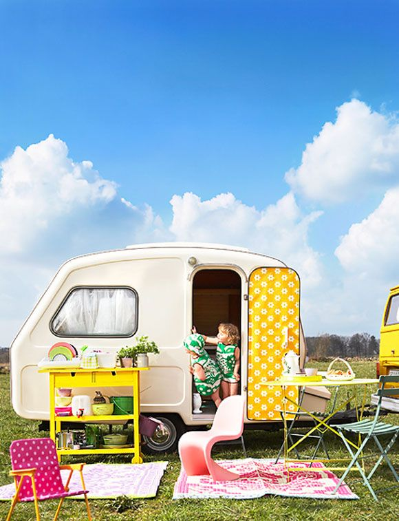 I love this picture. The trailer and the two little girls---cute!