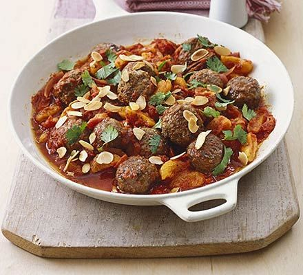 Speedy Moroccan meatballs ... oil, ready-made meatballs, onion, dried apricots, cinnamon, canned chopped tomatoes with garlic, toasted flaked almonds, coriander