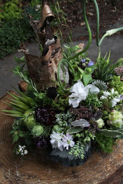 woodland arrangement with white and burgundy flowers