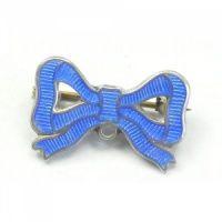 Blue enamel bow brooch