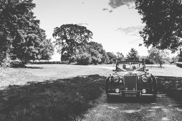 Nothing beats a classic... Photo by Benjamin Stuart Photography #weddingphotography #classiccars #weddingcars #transport