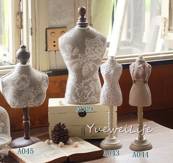 A set of similar styled mannequins, wood and fabric, great for use as jewelry display stand or home decor.