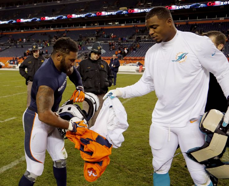 Denver Broncos strong safety T.J. Ward, left, exchanges jerseys with Miami Dolphins linebacker Chris McCain after an NFL football game, Sunday, Nov. 23, 2014, in Denver. The Broncos won 39-36. (3572×2903)
