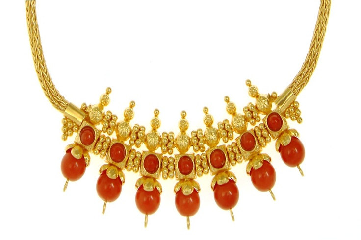 A Fancy Necklace crafted in Gold set with Corals