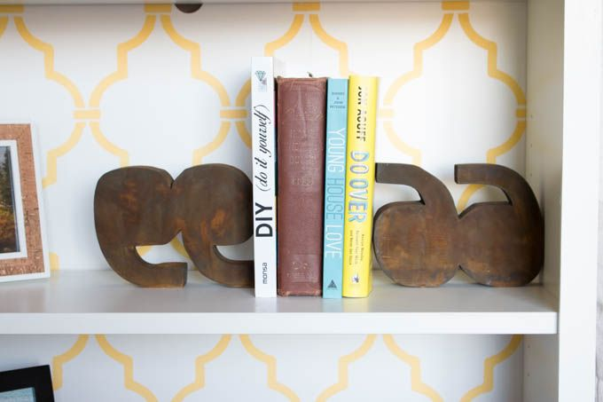 Create your own custom version of these adorable Anthropologie-inspired Quotations Marks Bookends using a few pieces of scrap wood.