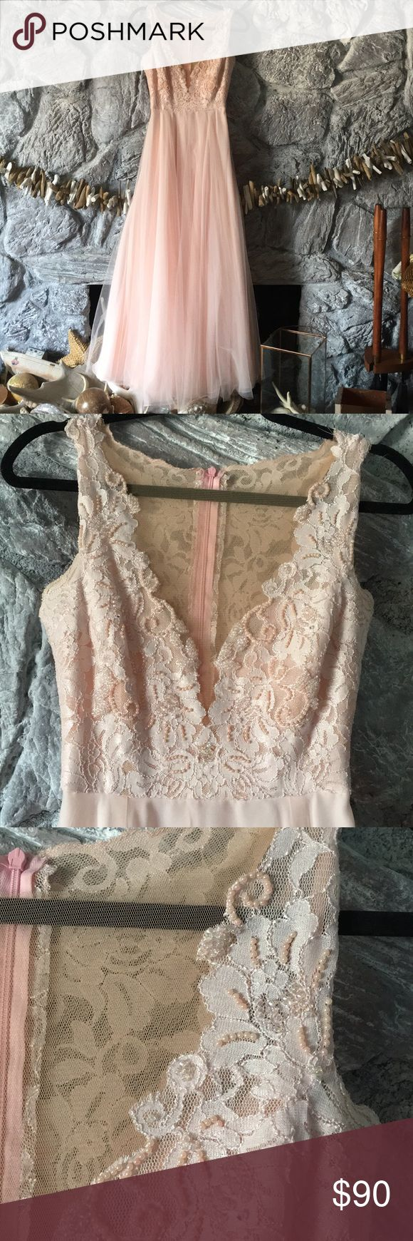 """Handmade and beaded prom dress. Professional seamstress made this dress for my daughter and it's flawless. It's pale pink and hand beaded lace. Measurements are approx. 15 1/2"""" from pit to pit. 15"""" shoulder to waist. 12"""" in flat on waist. 42"""" waist to hem. Petticoat slip which is separate from dress included. She wore a gold metal belt which is not included. For reference she is a 32C bra Dresses Prom #handmadebeltsfordress"""
