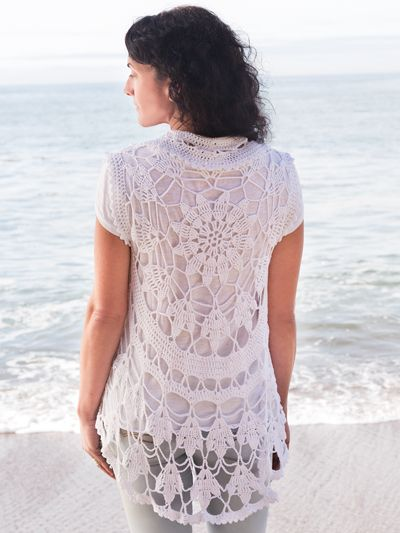 This openwork layering piece is certain to be the pièce de résistance of your spring apparel! Its circular shape gives swing to its drape, and it works for all body types. Made using 3 (4, 4, 5) balls of Universal Bamboo Pop, #3 DK-weight yarn. Sizes are...