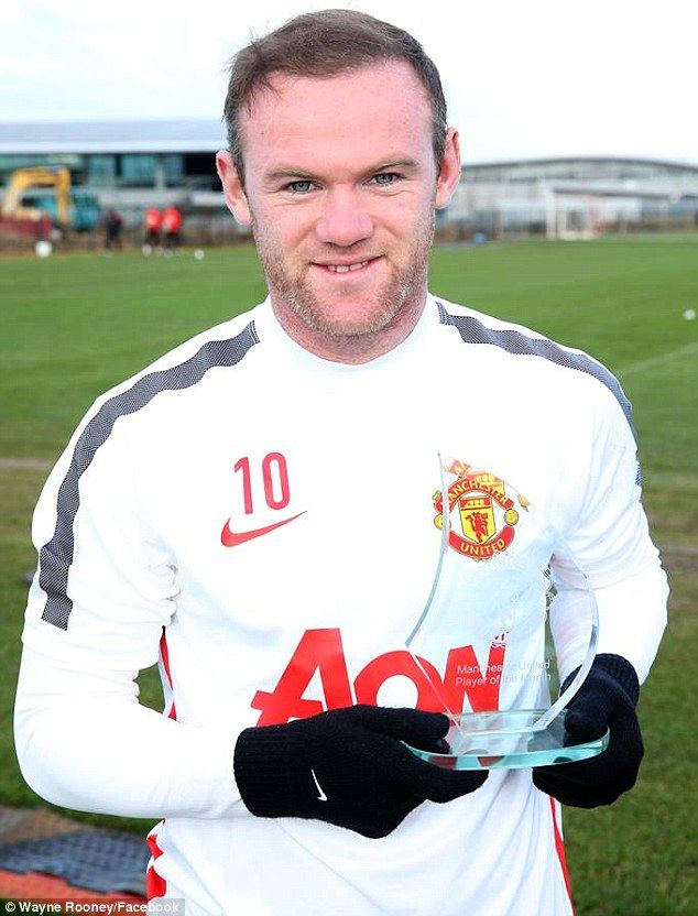 Wayne Rooney collected his December Player of the Month award after impressing over the Christmas period